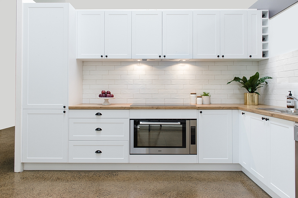 Shaker white kitchen with timber laminate benchtop