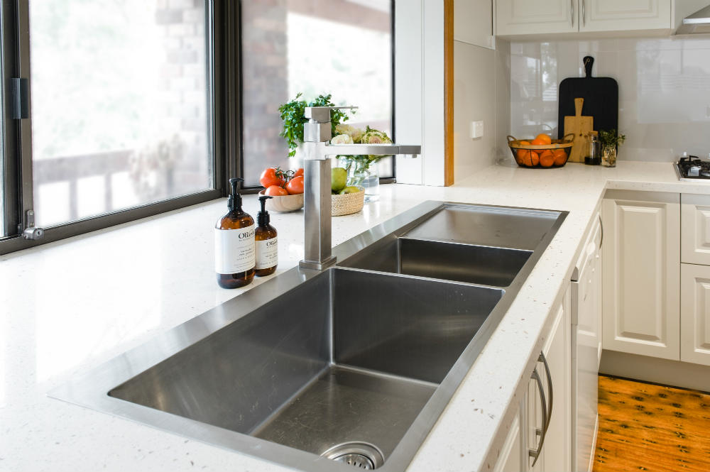 White kitchen with double sink and window
