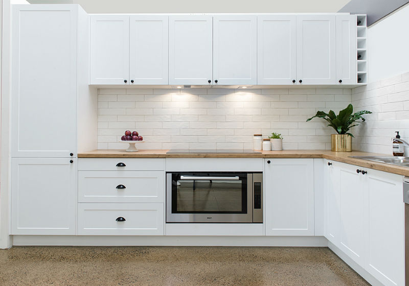 white ktichen with subway tiles and durapal benchtop