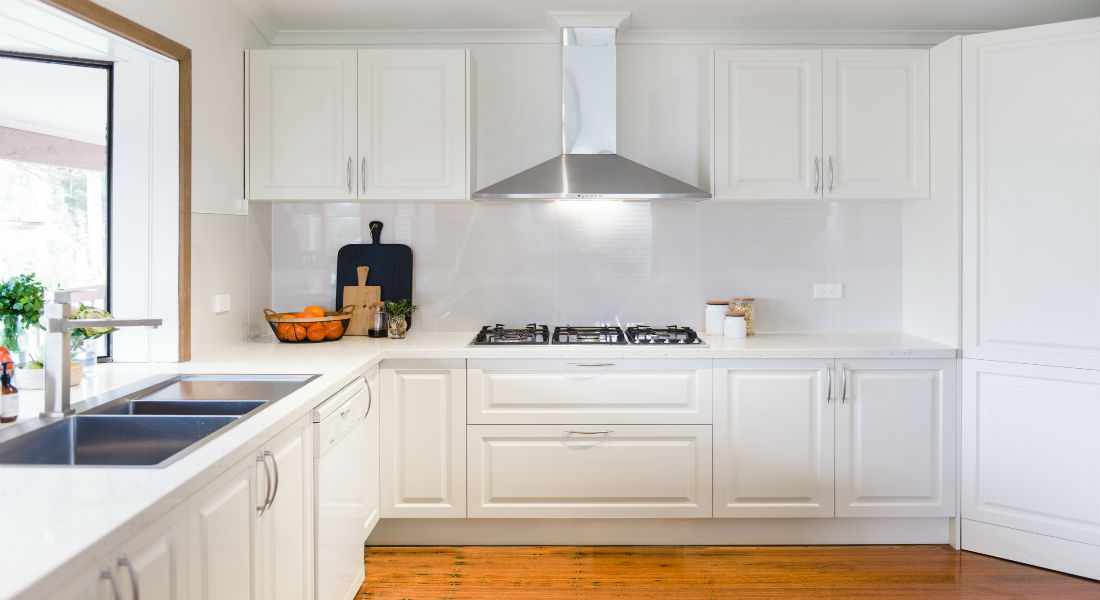 White budget kitchen with cooktop