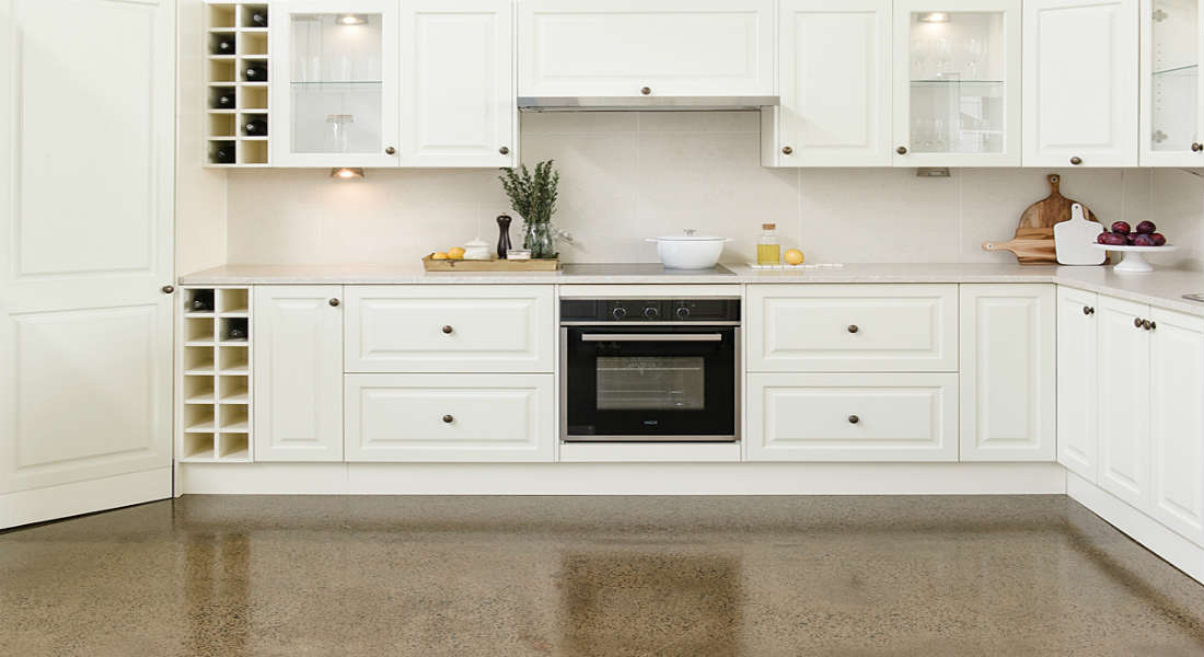 White flat pack kitchen with cabinets and cooktop