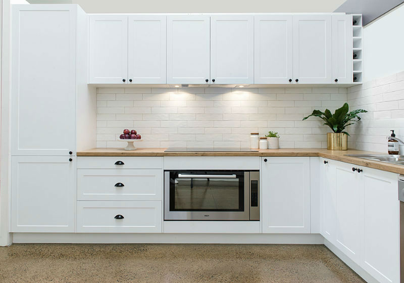 All white shaker style kitchen with tiled splashback