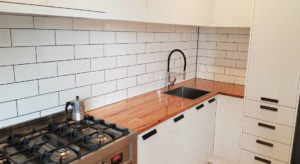 white kitchen with tiled splashback