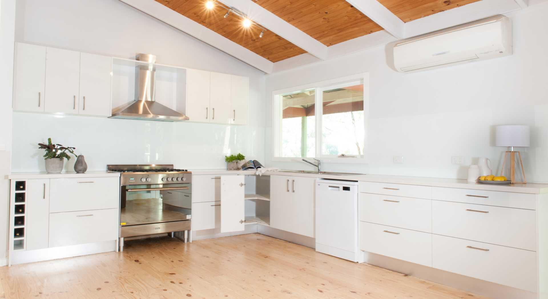 modern white kitchen with timber floor