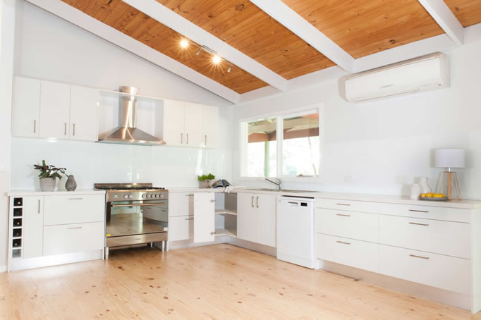white kitchen with timber racked ceiling