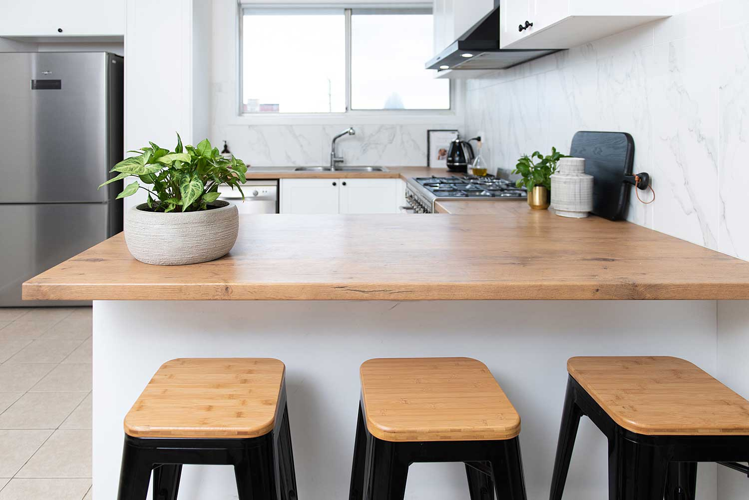 White kitchen with timber laminate benchtops