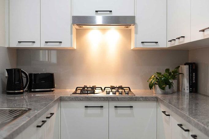 Cooktop and rangehood with underbench lighting