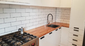kitchen with tiles splashback