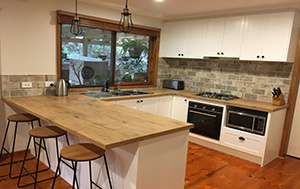 Shaker style u shape kitchen with timber tops
