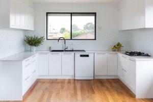 white kitchen with pressed tin splashback