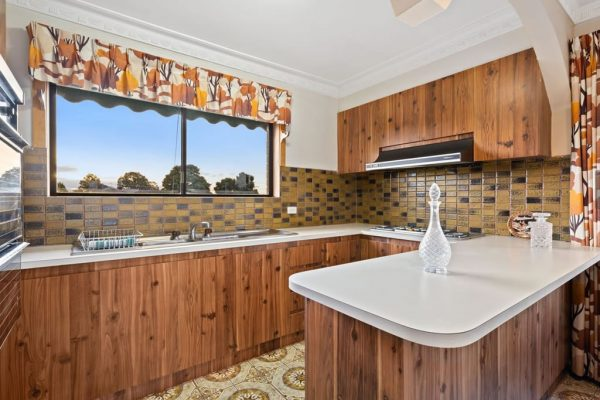 Old kitchen with dark cabinetry and mission brown tiles