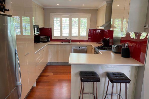 Old kitchen with red splashback