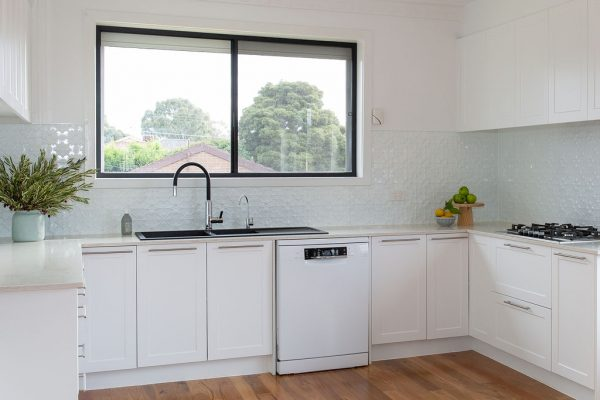 White shaker cabinetry in this u shaped kitchen