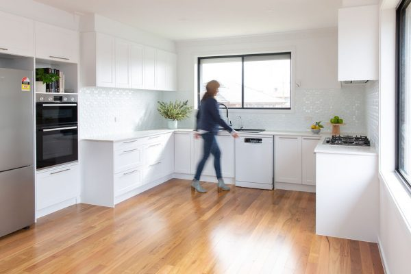 White shaker pantry and oven tower cabinetry