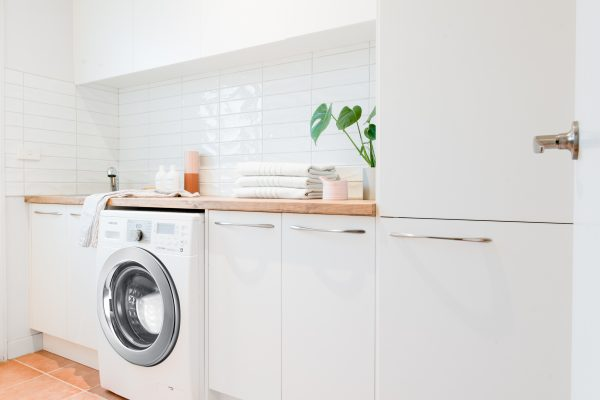 White and timber benchtops flatpack laundry